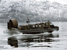 A Landing Craft Air Cushion of 539 Assault Squadron Royal Marines in Tranoy Fjorden, Norway during Exercise Joint Winter 2004. Picture by Darren Macdonald, HMS ALBION.
