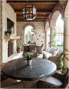 Patio-Mediterranean-arch-archway-brick-arch-column-covered-patio-fireplace-screen-hanging-lantern-outdoor-dining-outdoor-entertaining-outdoor-fireplace-outdoor-TV-pillar-stone-patio-table-stone-wall-wicker-patio-chair-wi-id-1592.jpg 770×996 pixels