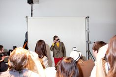 NYFW / backstage snap of Karen Walker model serving up some press snaps with a side of ham. Photo by Maia Harms
