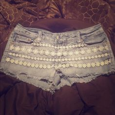 Blue jean shorts Blue jean shorts with flower detail on front. Lightly worn. Size 5/6 Rue 21 Shorts