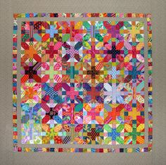 Kaffe Fassett fabrics scare me, but I love this use of them in a + and x quilt. Besos Y Abrazos Quilt Festival, Scrappy Quilts, Baby Quilts, Quilt Inspiration, Plus Quilt, Cross Quilt, Colorful Quilts, Bright Quilts, Quilt Modernen