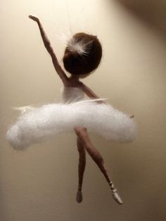 This is the character of the famous ballet of Tchaikovsky Swan Lake: an evil wizard transformed a beautiful girl Odette in the white swan. She is gentle, elegant, graceful... Her hair and crisp white dress decorated with white feathers. The hight is 14 cm.