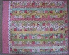 """Make quick baby girl quilts for upcoming baby showers with this Magic Jelly Roll Quilt. This baby quilt pattern will make bright and cheery baby quilts with """"magic"""" cutting and piecing that you can finish in just a few hours."""