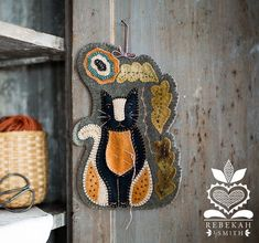 Newly released patterns from Rebekah L. Smith. The Kitty Sewing Caddy is now available for purchase. Make your own cute sewing companion. #woolapplique #stitching #wool #patterns #folkart