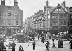 'Spitalfields market, London' shows horse-drawn carriages making their way down the bustling cobbled street in the early 1900s
