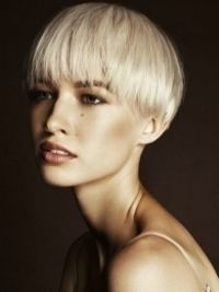 I do not like the hair cut, but what a beautiful face...luminous skin, lovely shade of lipstick.