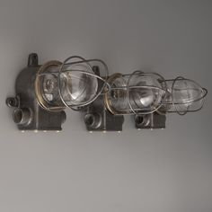 "Large run of steel and glass naval passageway lights by ""Osaka Tokushu"" salvaged from decommissioned Japanese cargo ships in India."