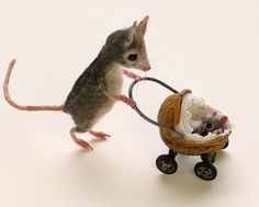Fairy oe Mouse House Baby Carriage ~The pram is made from a walnut shell with a . Fairy oe Mouse House Baby Carriage ~The pram is made from a walnut Needle Felted Animals, Felt Animals, Cute Animals, Cute Mouse, Mini Mouse, Wet Felting, Needle Felting, Walnut Shell Crafts, Felt Mouse