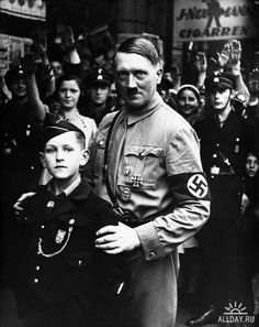 The Fuehrer poses with the Future of Nazi Germany, a very young member of the Hitler Youth. A dark image, both literally and metaphorically.