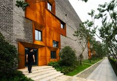 esigned by Höweler + Yoon Architecture, the Sky Courts corporate building is erected in Chengdu, China. The mixture of contemporary looks and modernism themes, the Sky Courts inherit both characteristics. The reinterpretation of a traditional Chinese club house consists of wood panels and a sloping roof top.