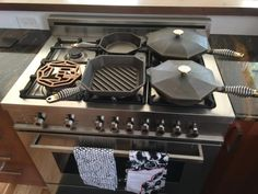 Finex Cast Iron from Portland, Oregon USA, This is Finex's complete line up as of 9-1-2015.  It includes the No.12 skillet with lid, No. 10 with lid, No. 10 grillet pan, No. 8 skilet and a rosewood trivet.