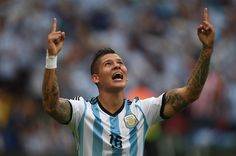 Let Lionel Messi Show You What A Perfect Free Kick Goal Looks Like - Argentina's defender Marcos Rojo celebrates his goal, during a Group F football match between Nigeria and Argentina at the Beira-Rio Stadium in Porto Alegre during the 2014 FIFA World Cup on June 25, 2014.