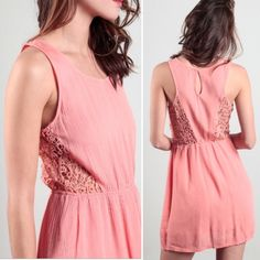 Embroidered crochet lace cut out boho dress coral Sweet coral pink dress in gauze cotton with embroidery crochet side cut outs. Boho chic. Elastic waist. Super cute for spring, summer and festival wear! Listed Free People style. Lola is brand. Cotton.  *Available in small, medium, large.  *This listing is for a small. Lola Dresses Mini