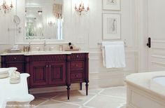 Elegant white, tone on tone bathroom, lovely vanity.
