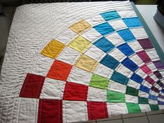 Robert Kaufman Kona Solids Challenge for the MQGs by Miss Emily D. -  I like this take on the color wheel.  Would go great with my playroom for the girls.  Might have to make a second quilt for that room??