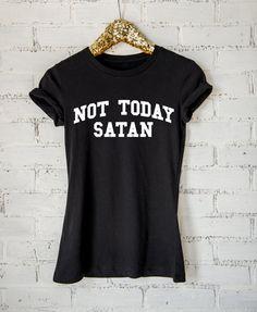 Keep those bad vibes away with this sassy shirt.