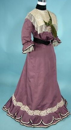 c. 1900 Trained Afternoon -2-piece Gown of Amethyst Bengaline, Trimmed in Lace and Ribbon Frills with Green Velvet Bow