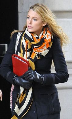 Blake Lively knows what she's doing when the temperature starts to drop! Black leather gloves and a colorful print scarf are what we are loving for the cold.