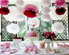 Entertaining pink red white paper garland decorations dessert table paper pom poms