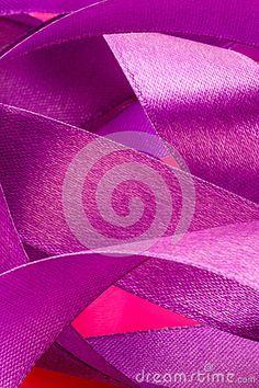 A closeup mauve ribbon on a pink background