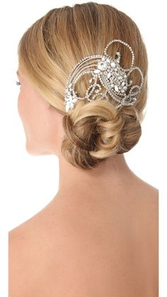 Jenny Packham Valentine Comb Twinkling Swarovski crystals and imitation pearls accent this swirling hair comb, a pretty piece that adds a delicate touch of '20s glamour to any look.    Imported, India.    MEASUREMENTS  Length: 6in / 15cm