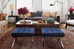 Modern apartment design - Lisa Pomerantz of Botega Veneta | Grey sofa, Barcelona stools