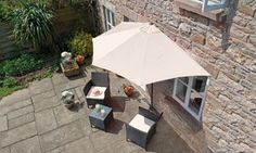 This semi-circular parasol is designed to provide protection from the sun in the summer and to add a touch of colour to most balconies