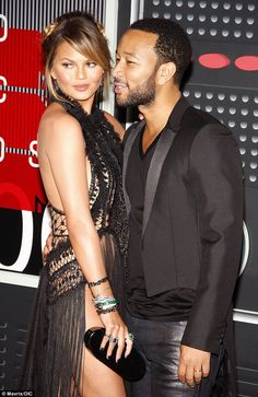 Getting personal: Chrissy Teigen and John Legend at the MTV Video Music Awards in LA on August 30