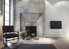 Paris apartment - grey, white and neutral decor, burgundy antique turned chair and a tromp l'oeil mural