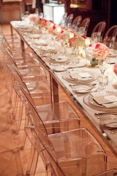 modern wedding with lucite tables, lucite chairs, pink flowers, glass and gold chargers love the clear chairs