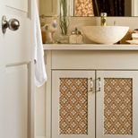 Love this idea to stencil on the doors of drab cabinets...although I hear stenciling isn't easy @Rachael Hale Cook