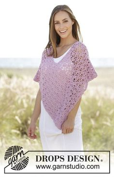 Crochet poncho with lace pattern in DROPS Paris. Size: S - XXXL Free pattern by DROPS Design.