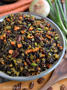 The best Wild Rice recipe - A recipe that lives up to its name! Tender wild rice tossed with vegetables, currants and pecans and cooked in an orange-vermouth broth. Very delicious!