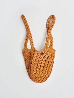 Made in Spain, the Gabi shoulder bag features linked pieces of supple leather in Calabaza. Gabi, Pop Bottles, Second Skin, You Bag, Bag Sale, Designer Shoes, Straw Bag, Shoulder Bag, Jewels