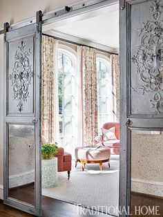 Antique mirror-and-wood doors found in France were repurposed as sliding barn-style doors for this home office. - Photo: Emily Jenkins Followill / Design: Carolyn Kendall with Betsy Trabue
