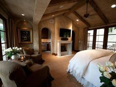 Luxury Master Bedrooms gorgeous neutral master bedroom with fireplace, curtains and built