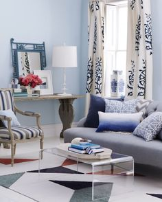 By picking blues that are more neutral than primary, you can get away with a lot -- in this case, seven patterns and an eclectic grouping of furnishings and accessories in one living room. The space oozes comfort because the blues have undertones of gray or beige that allow the patterns to happily mingle. And they make it easy to add playful pieces such as an exuberant Victorian mirror framed in steel blue. Using patterns of different scale also helps hues coexist. A custom carpet, made...