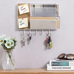 With enough room for ingoing and outgoing mail, letters, postcards, documents, schedules, reminders, keys, and more, this white metal mesh mail sorter rack brings organization into every entryway, (home) office, and living room. This storage rack features 2 slots for keeping your letters and postcards. A big cork board is perfect for pinning up notes, photos and much more. 5 hooks offer plenty of room for keys, lanyards, and leashes. Easy to mount to wall surfaces, this organizer will make… Mail Organizer Wall, Key Organizer, Organizers, Mail Storage, Storage Rack, Entryway Hooks, Entryway Decor, Metal Board, Mail Sorter