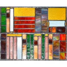 Glass art for the avid reader -  a bookshelf filled with books made from opal glass. Designed and made by Radiance Stained Glass.