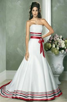 White strapless gown with multicolor satin ribbon trim