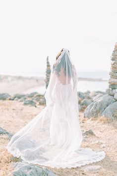 Maria's backless wedding gown has been perfectly coupled with a bespoke veil. Modern and gorgeous by @ilovestylianos