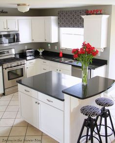 White Kitchen Remodel with Painted White Cabinets and Black Quartz Countertops | remodelaholic.com #kitchen #remodel #paintedcabinets @Remodelaholic .com