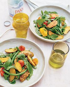 Roasted Fingerling and Tomato Salad with Green Beans and Arugula  Roasted potatoes are perfectly suited to summer when tossed with peppery arugula to offset their richness. Served warm or at room temperature, this salad is a substantial side that can double as a light lunch.