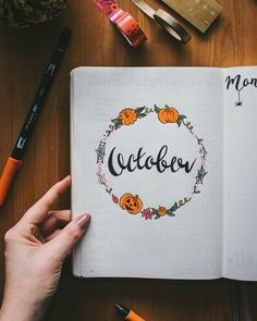 Halloween theme bullet journal spreads including October monthly cover page by @teaandcreate