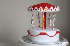 This carousel cake was made for a 2-year-old cutie who loves merry-go-rounds and giraffe! I decorated this cake with rolled fondant, red stripe paper straws and horses and giraffe made with cut-out icings. The biggest surprise is the inside of the cake - it's a beautiful rainbow vanilla layer cake with six pretty colours which consist of red, orange, yellow, green, blue and purple from roof to bottom!