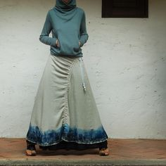 Love the sweatshirty thing with quirky long skirt.