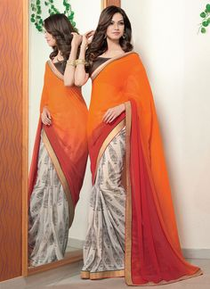 Make the heads turn whenever you costume up in this pretty multi colour georgette designer saree. The amazing attire creates a dramatic canvas with amazing lace and print work. Comes with matching blo...