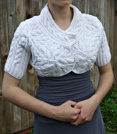Its a little versatile handknitted bolero jacket made with cotton. It fits lots of style and body types also it looks great with jeans or dress.This cropped hand knitted bolero jacket has a heavily structured cabled pattern.Hand knitted cables forms several stars on the back and front with