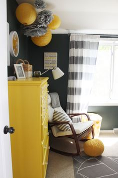Navy, yellow, gray nursery - check out the lanterns and puffs!