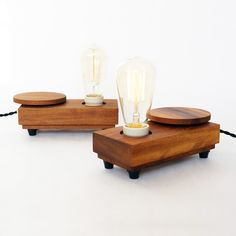 Lamp 'Disc'. This lamp is handcrafted in small series of oiled Iroko wood. The horizontal disc operates the dimmer and switches the lamp on/off.